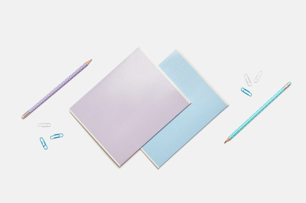 Colored school supplies for learning on white, flat lay