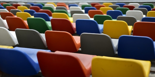 Colored seats on a football field Premium Photo