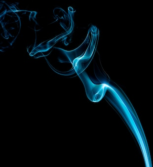 Colored smoke shapes on black background