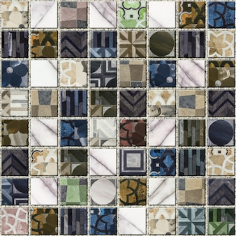 Colored stone mosaic with an abstract pattern. geometric seamless background texture. element for wall and floor decor