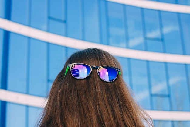 Colored sun glasses at the nape of the girl