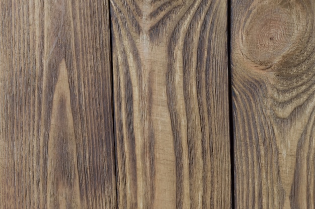 Colored textural background of light wooden boards arranged vertically.