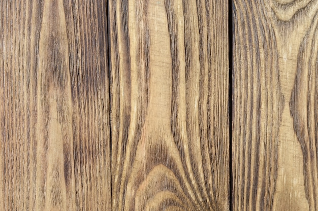 Colored textural background of wooden boards arranged vertically.