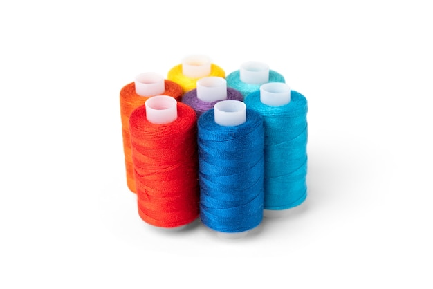 Colored threads on white background.