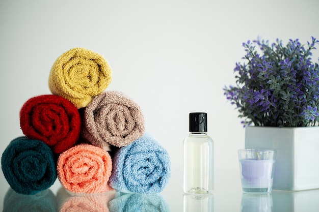 Colored towels on white table with copy space on bathroom