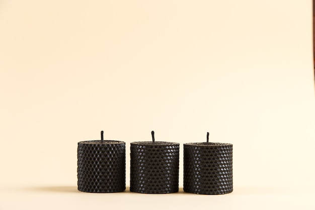 Colored, unusual handmade candles, of natural wax with texture of honeycomb bees, an element of the interior.