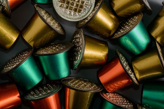 Colored and used coffee capsules in close-up.