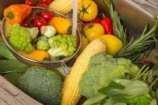Colored vegetables in metal colander