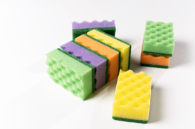 Colored washcloths for washing dishes on a white background