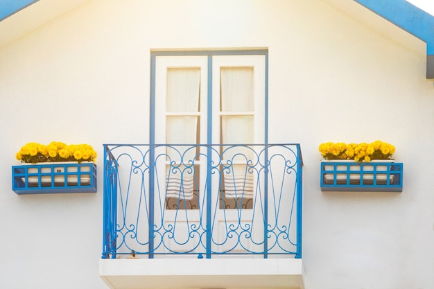Colored window and balcony in typical small wooden house with colorful stripes in costa nova aveiro