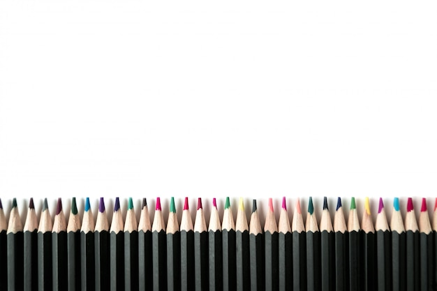 Colored wooden pencils on white table