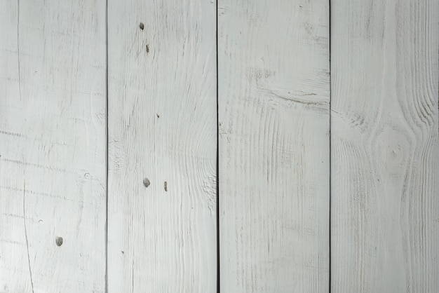 Colored wooden planks with cracks and scratches, table or texture
