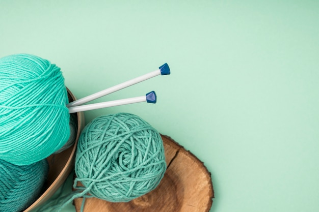 Colored wool yarn with crocheting needles