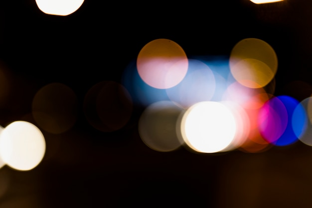 Colorful abstract bokeh background on dark backdrop
