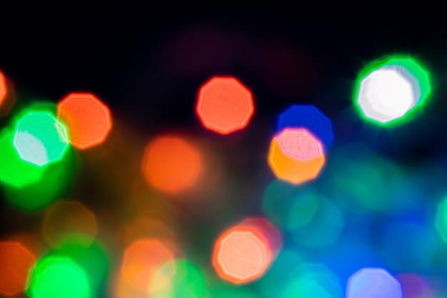 Красочное абстрактное bokeh освещает предпосылку. предпосылка боке на сезон фестиваля.