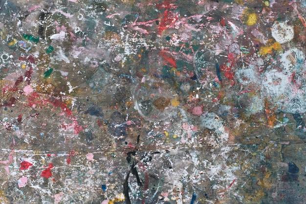 木製の背景にカラフルな抽象的な塗料