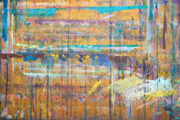 カラフルな抽象化。テクスチャ、木製の背景に色のペンキで背景画