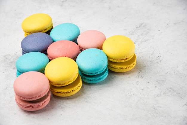 Colorful almond macarons on white background. billiard concept.