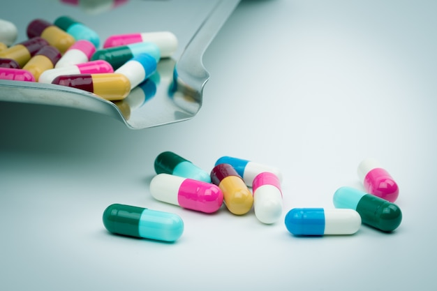 Colorful of antibiotic capsules pills on stainless steel drug tray, drug resistance