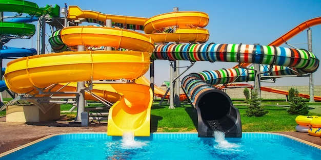 Colorful aquapark slide with pool for everyone