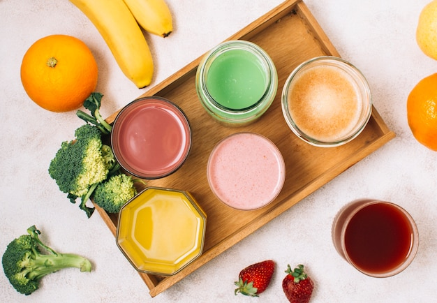 Colorful arrangement of smoothies and fruits
