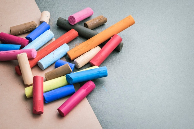Colorful art pastel crayons on a drawing paper with place for text