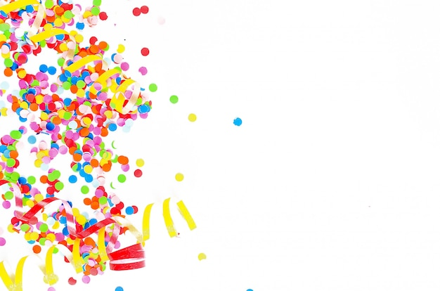 Colorful assorted confetti with serpentine on white background