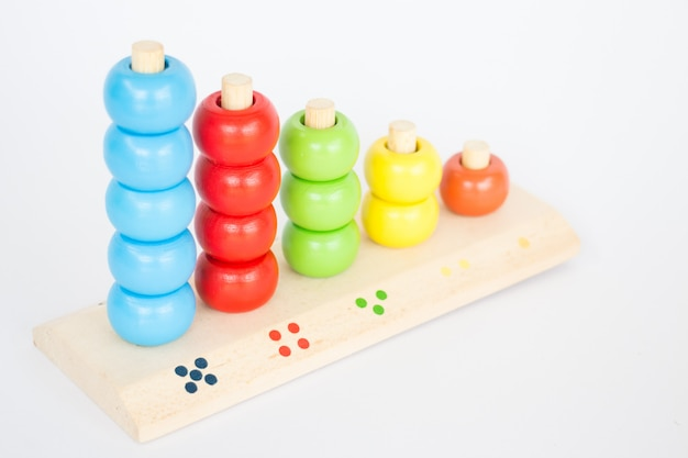 Colorful backgammon wooden toy on white table