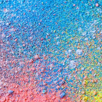 Colorful background of chalk powder. multicolored dust particles splattered.