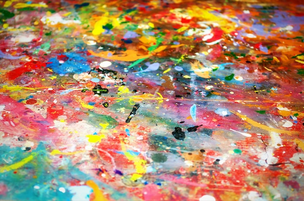Colorful background of multicolored paint