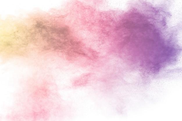 パステルパウダー爆発のカラフルな背景。白い背景の上の複数の色のほこりスプラッシュ。塗装ホーリー。
