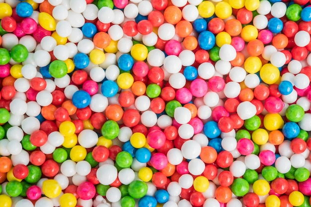Colorful background texture with sugar candy sprinkles dot