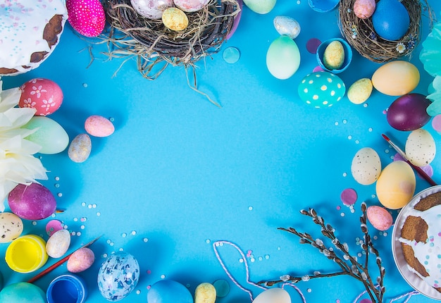 Colorful background with easter eggs on blue background