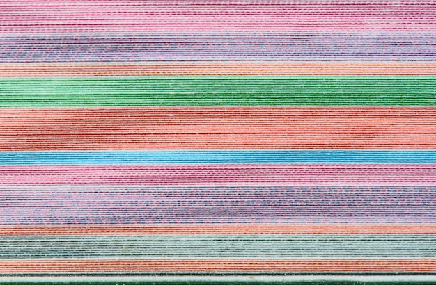 Colorful background with soft faded rainbow-colored horizontal stripes