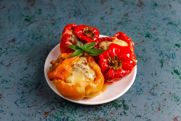 Colorful baked with cheese, stuffed peppers with minced meat.