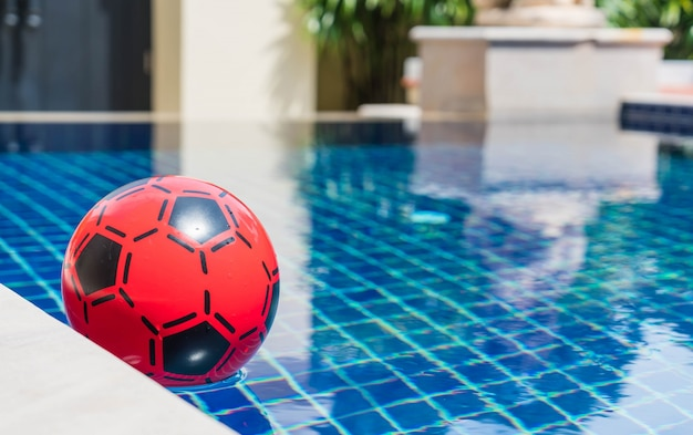 Colorful ball floating in a swimming pool