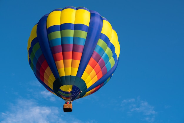 Colorful of balloon on blue sky with copy space