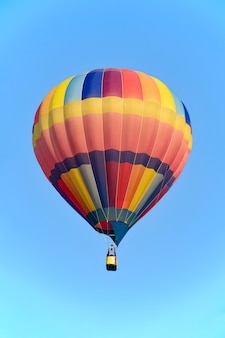 Colorful balloon over bright sky.