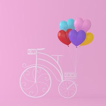 Красочные воздушные шары форме сердца повесить белый велосипед урожай на розовом фоне. минимальное co