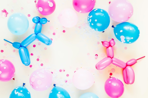 Colorful balloons and balloon dogs on pastel color background. festive or birthday party concept. flat lay, top view.