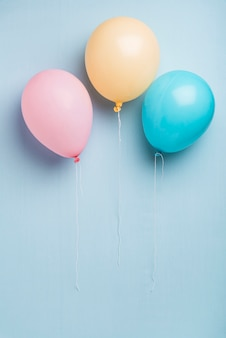Colorful balloons on blue background with copy space