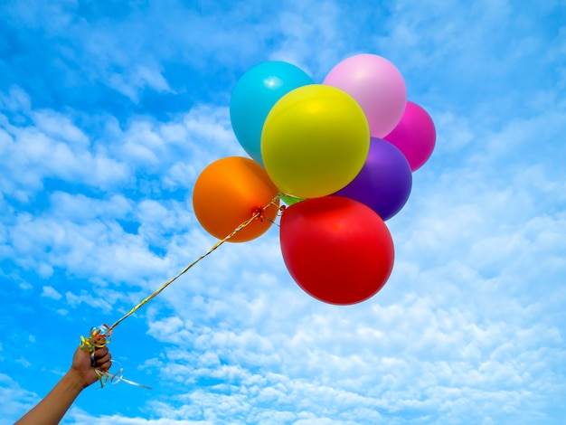 Colorful balloons on blue sky background.
