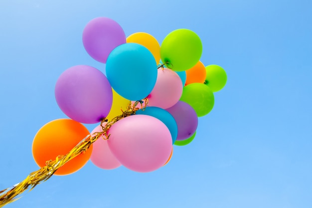 Colorful balloons done with a retro on bluesky backgroud