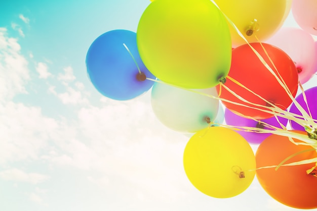 Colorful balloons done with a retro filter effect. concept of happy birth day in summer and wedding, honeymoon party. vintage color tone style