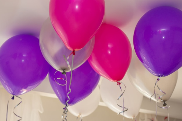 Colorful balloons floating on ceiling of party