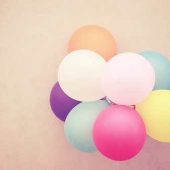 Colorful balloons on wall with retro filter effect