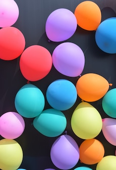 Colorful balloons with celebration and various party confetti