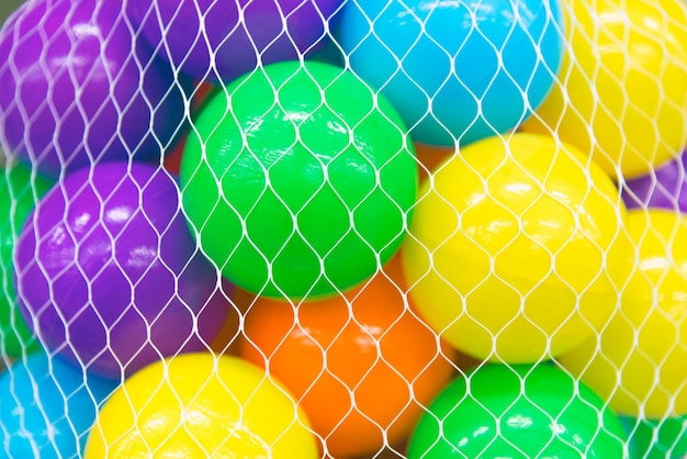 Colorful balls in a white net cover or mesh bag.
