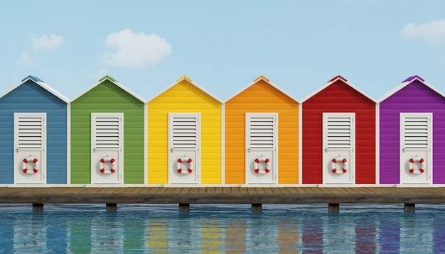 Colorful beach cabins on wooden pier
