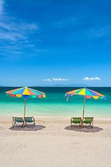 Colorful beach chairs with umbrellas on a sunny day